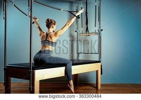 Pilates Reformer Bed, Concept Pilates Body Hormone, Woman And Instructor Doing Exercises On The Simu