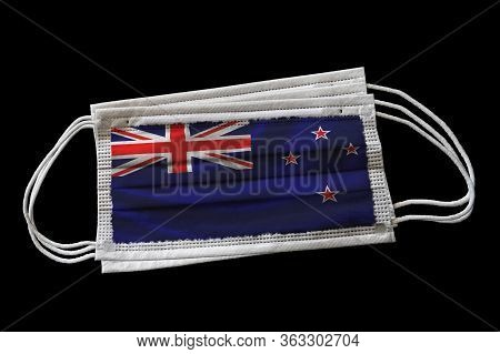 3d Rendering Of Surgical Face Masks With New Zealand Flag Printed. Isolated On Black Background. Con