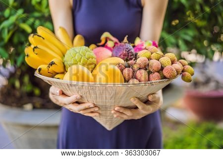 Variety Of Fruits In A Vietnamese Hat. Woman In A Vietnamese Hat