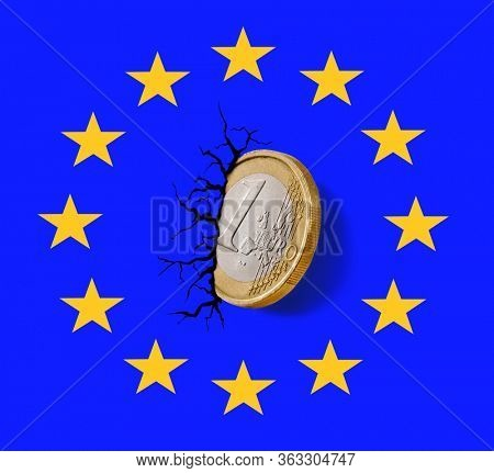 Europe Union collapse economy on Euro coin embedded on logo wall and crack.