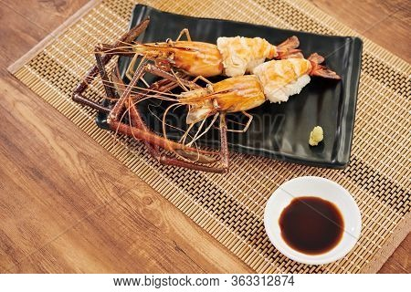 Served Tasty Cooked Spiny Lobsters And Small Dish With Soy Sauce On Bamboo Napkin