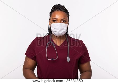 African American Doctor In A Medical Mask Over White Background. Medicine, Healthcare And People Con
