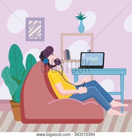Man Listens To Music In A Comfortable Chair Cozy Interior On Social Distancing. Stays At Home Quaran