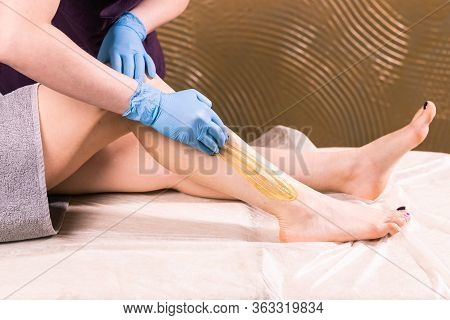 Hair Removal At Spa Luxury Shop. Women Legs Wax With Sugaring. Hot Sugar.