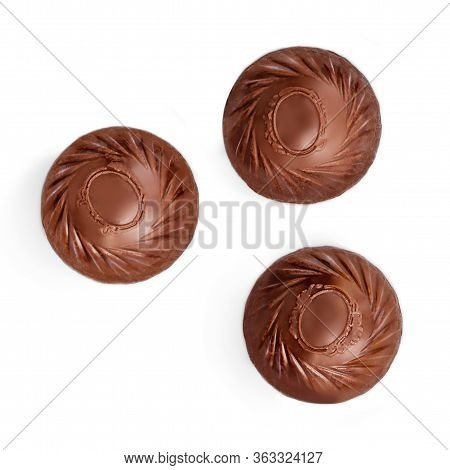 Chocolate Praline Candies  Isolated On White Background. Candies Collection. Top View. Flat Lay