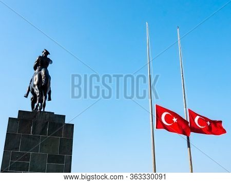 11.10.2018: Turkey, Izmir. Mustafa Kemal Ataturk Riding Horse Sculpture Silhouette And Turkish Flag,