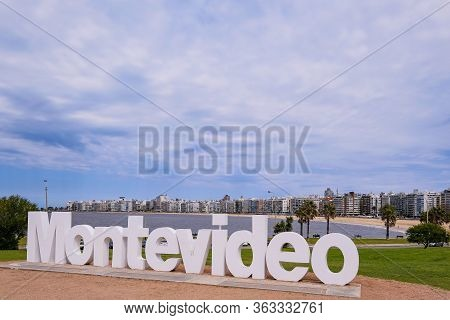 Montevideo Written In Giant Letters At The Eastern City Access, The Skyline In The Background, Monte