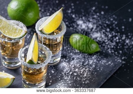 Tequila With Lime On Dark Table With Sprinkled Salt