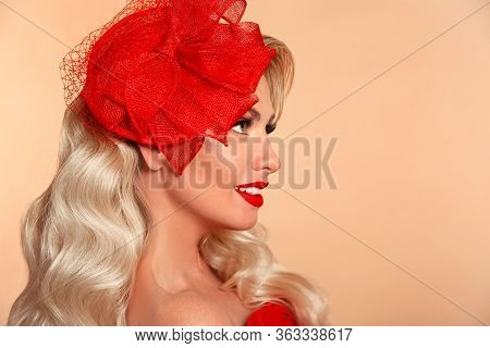 Beautiful Elegant Woman With Red Lips In Fashion Hat Smiling Isolated On Beige Studio Background. At