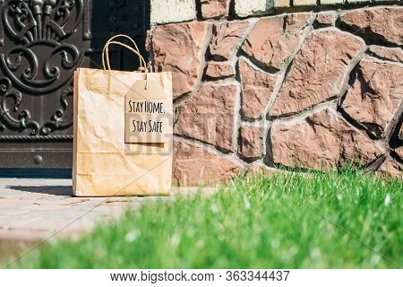 Contactless, Contact Free, Shipment Delivery Concept. Shopping Kraft Bag With Cardboard Stay Home, S