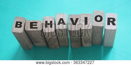 Behavior Word In Wooden Cube. Psychology Human Resources Management Concept