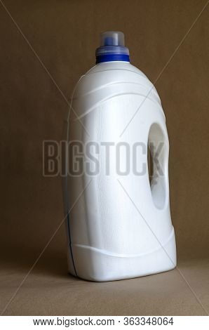 White Plastic Canister On Beige. Gel For Washing Canister. Household Chemical Goods. Selective Focus