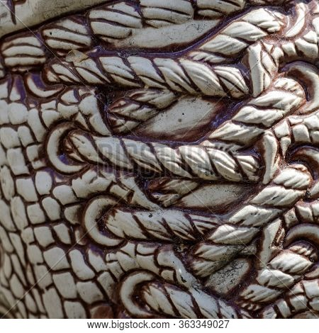 Fragment Of A Ceramic Statue Outdoors. Shoe Lacing On Ceramic. Lacing Pattern Pattern On A Ceramic B