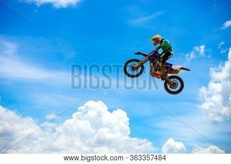 Motocross Rider Jump In A Blue Sky With Clouds.enduro Bike Rider In Action.