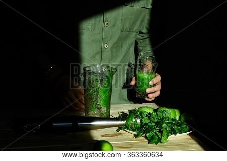 Man Hold In Hand Glass With Healthy Detox Smoothie, Cooking With Blender