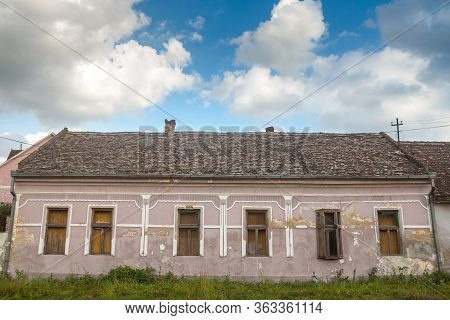 Facade Of An Hold House Building From An Abandoned Farm Of Voivodina, In Serbia. The Region Of Balka