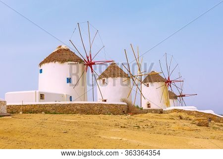 Greek Iconic Windmills Panoramic Background In Mykonos, Greece, Famous Island In Cyclades
