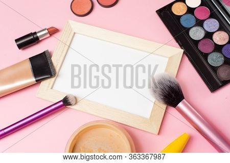 Cosmetics Is On The Pink Backgroud. Makeup With A Frame In Close View. Concealer, Brush, Eyeshadow W