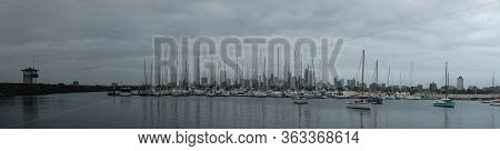 Panoramic Of The City Of Melbourne Against A Sunny Blue Sky Seen From St Kilda Pier Looking Through