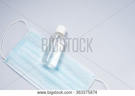 Antiseptic And Protective Mask For The Respiratory Tract On A Blue Background. Precautions For The C