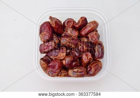 Dates In Jars, Dates Isolated On A White Background, Ripe Dates Ready To Eat