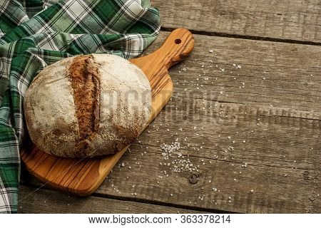 Freshly Baked Traditional Bread On Wooden Table With Salt.