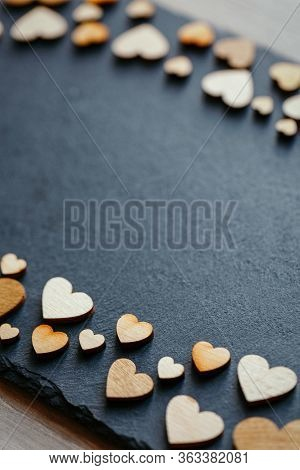 Heart Shape Made Of Natural Wood. Beautiful Heart Shaped Wooden Little Hearts On Black Background