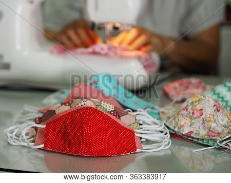 Woman Use Sew Machine To Sewing Face Medical Mask Protective Against During The Dust Pm 2.5, Coronav