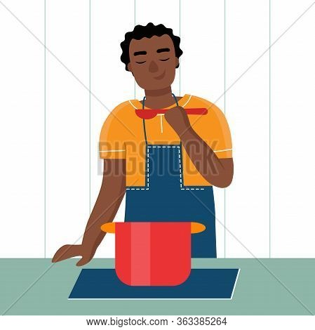 A Young Black African Man Cooks At Home In The Kitchen. Husbands Household Duties. Flat Vector Carto