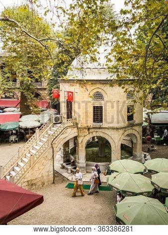 Bursa, Turkey - August 14, 2019: People At The Tea Garden Of Historical Koza Han (silk Cocoon Carava