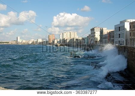 Waves From The Caribbean Sea Crashing Against The Wall Of The Malecon Promenade In Havana, Cuba On A