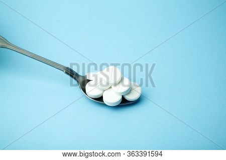 Pills And Drugs On A Spoon. Dosage And Medication. Vitamins, Anti-depressants, Stimulants, Sleeping