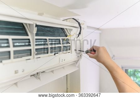 Repair And Fix Air Conditioner At Home. Lock Down And Self-quarantine At Home During The Corona Viru