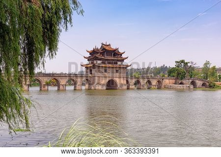 The Double Dragon Bridge In Jianshui County, China. Constructed In 1800s With Three Towers And 17 Ar