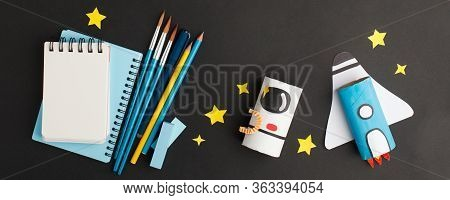 Back To School Background With Rocket And Astronaut Made From Toilet Tube Roll On Black Background,