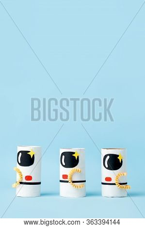 Toys Astronaut On Blue Background With Copy Space For Text. Concept Of Business Launch, Start Up, Ha