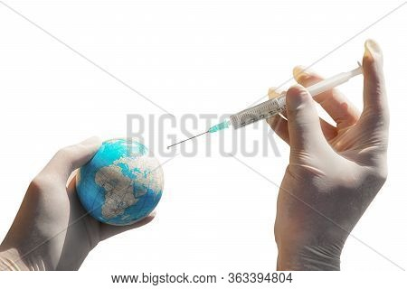 Injection Syringe In Hand With Gloves. Coronavirus Covid-19 Treatment. Planet Earth Treatment Concep