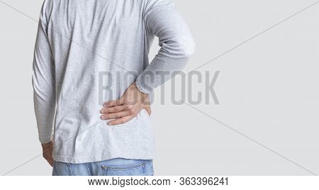 Muscle Spasm, Rheumatism Concept. Man Holds To His Back With Hand, Back