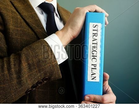 Businessman Is Holding Folder With Strategic Plan.