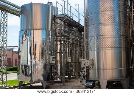 Modern Metal Tanks For Maturing And Cooling Wine Outdoor. Winemaking. Winery Equipment. New Modern W