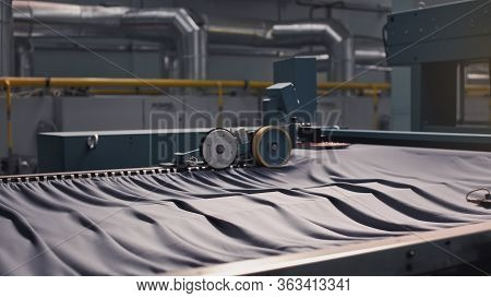 Textile Manufacturing. Circular Knitted Fabric. Textile Factory In Spinning Production Line And A Ro