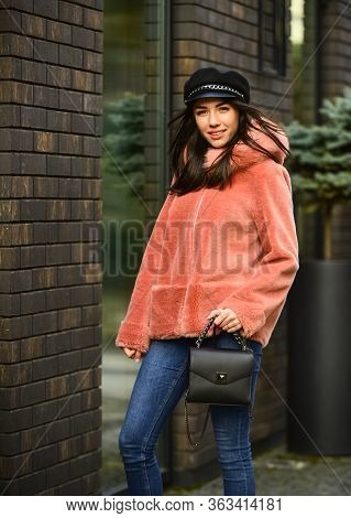 Winter Clothes. Natural Wool Sheepskin Coat. Fur On Hood. Stay Warm And Fashionable. Glamorous Lady.