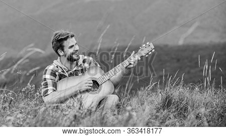 Keep A Song In Your Heart. Sexy Man With Guitar In Checkered Shirt. Hipster Fashion. Western Camping