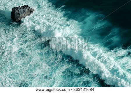 Aerial View Of Breaking Ocean Waves. Close Up Shot Of A Blue Foaming Waves