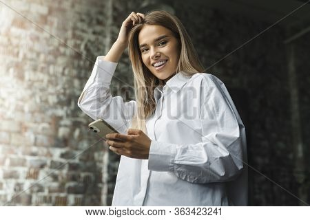 Female Using Mobile Phone For Work, Calling Customers And Managers, Sending Text Messages, Checking