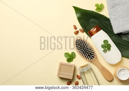 Composition Of Personal Hygiene With Bottles Of Cosmetics On Beige Background