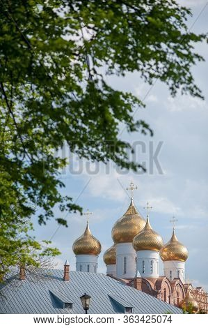 Domes Of A Religious Building. Crosses On The Domes Of The Church. Cathedral With Silver Domes Again