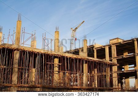 Empty construction site with unfinished incomplete building.
