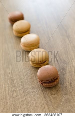 Colorful Macarons In Brown And Earth Colors. Sweet French Cakes.