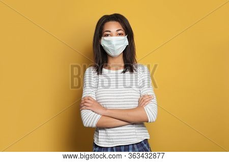 Optimistic African American Woman In Medical Face Mask On Yellow Background